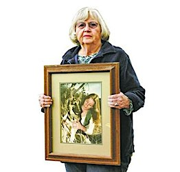 Aba Gayle holds a photo of her daughter, Catherine Blount who was murdered